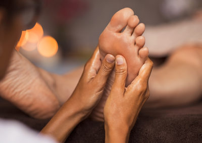 Keep in Touch Masseuse giving foot massage